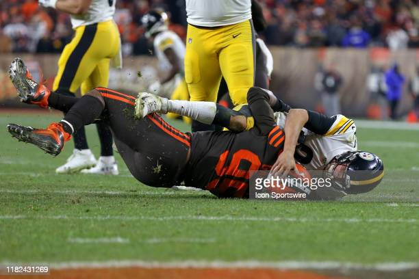 Cleveland Browns defensive end Myles Garrett takes Pittsburgh Steelers quarterback Mason Rudolph to the ground during the fourth quarter of the...