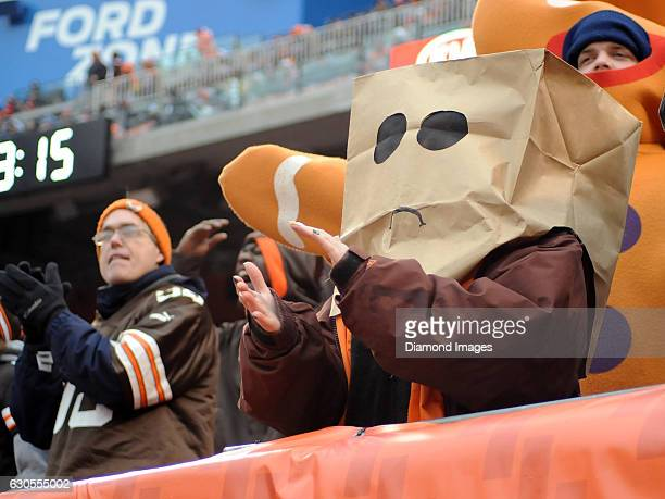Cleveland Browns fan applauds as they watch the action while wearing a bag on their head during a game against the San Diego Chargers on December 24...
