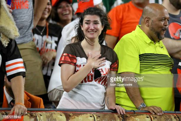 Cleveland Browns fan is near tears after the Browns scored ago take the lead during the fourth quarter of the National Football League game between...