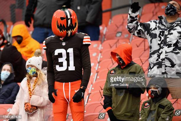 Cleveland Browns fan looks on, while wearing a 'Halloween pumpkin' mask, during the second half of the NFL game against the Las Vegas Raiders at...