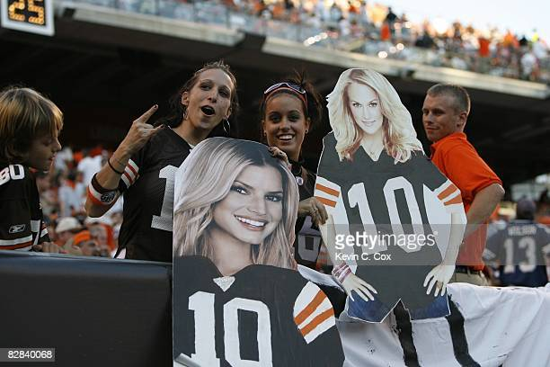 Cleveland Browns fans display cardboard images of Jessica Simpson and Carrie Underwood in an attempt to distract Tony Romo of the Dallas Cowboys...