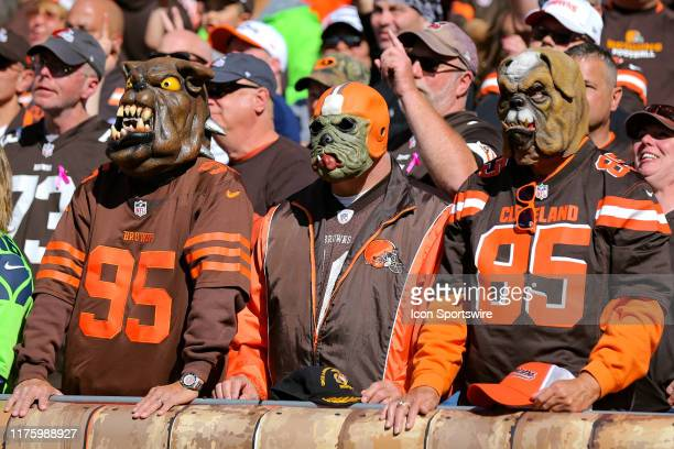 Cleveland Browns fans in dog masks in the Dawg Pound during the second quarter of the National Football League game between the Seattle Seahawks and...