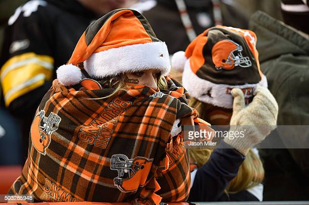 Cleveland Browns fans look on during the fourth quarter against the Pittsburgh Steelers at FirstEnergy Stadium on January 3 2016 in Cleveland Ohio