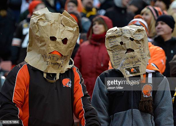 Cleveland Browns fans look on during the fourth quarter against the Pittsburgh Steelers at FirstEnergy Stadium on January 3 2016 in Cleveland Ohio...