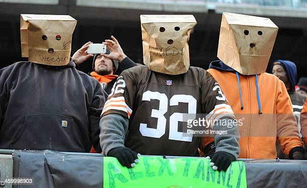 Cleveland Browns fans sit in the stands with paper bags over their heads during a game between the Cleveland Browns and Jacksonville Jaguars at...