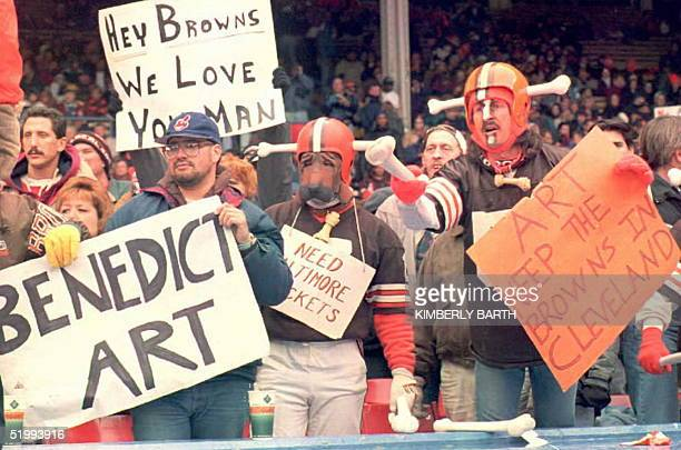"""Cleveland Browns fans, some dressed in the team's """"Dog Pound"""" attire, show both their love for the team and their displeasure with Browns owner Art..."""