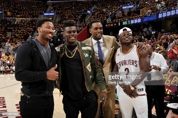 Cleveland Browns firstround draft picks Myles Garrett Jabrill Peppers and David Njoku pose for a photo with Chris Webber before Game Three of the...