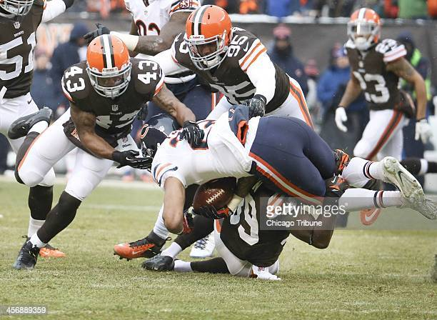 Cleveland Browns free safety Tashaun Gipson tackles Chicago Bears running back Matt Forte with the help of Browns strong safety TJ Ward and Browns...