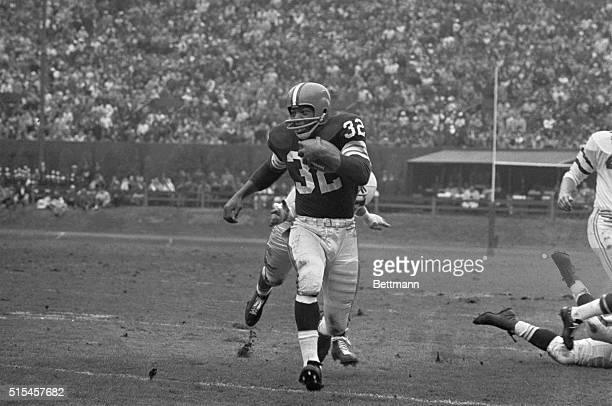 Cleveland Browns' fullback Jim Brown scampers on a 13 yard gain in first period in NFL clash with Philadelphia Eagles Brown scored four touchdowns...