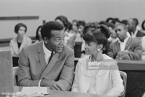 Cleveland Browns' fullback Jim Brown talks with his wife Sue during a court recess in which Brown is on trial for allegedly beating an 18-year-old...