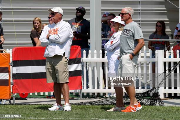 Cleveland Browns general manager John Dorsey watches practice along with owners Dee and Jimmy Haslam during the Cleveland Browns Training Camp on...