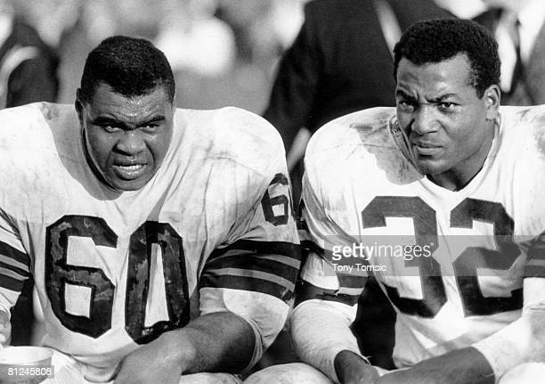 Cleveland Browns guard John Wooten shares the bench with Hall of Fame running back Jim Brown during a 3333 tie with the St Louis Cardinals on...