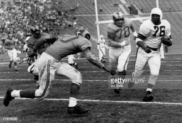 Cleveland Browns Hall of Fame fullback Marion Motley on a carry in a 2417 loss to the Los Angeles Rams in a League Championship game on December 23...