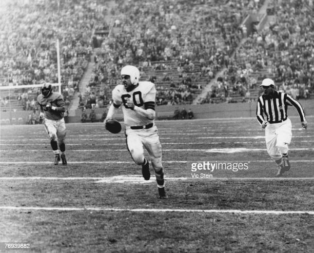 Cleveland Browns Hall of Fame quarterback Otto Graham on a run in a 2417 loss to the Los Angeles Rams in a League Championship game on December 23...