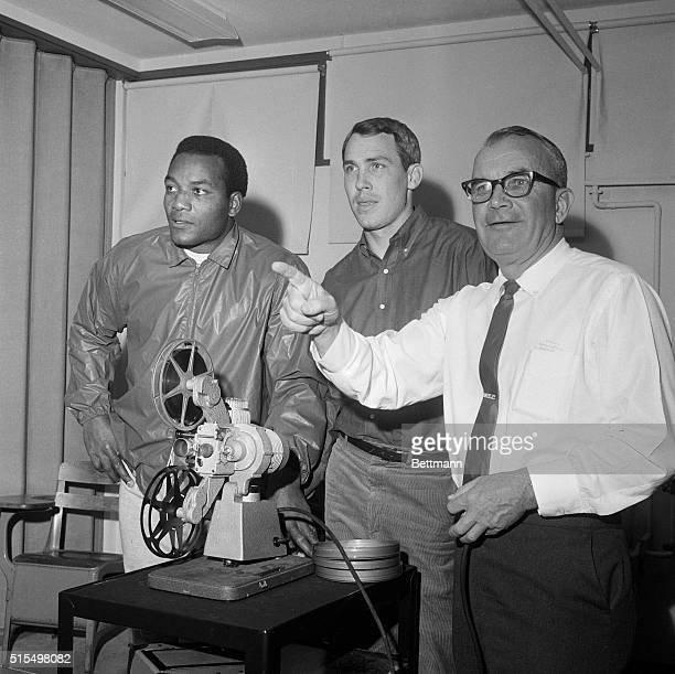 Cleveland Browns head coach Blanton Collier seems well pleased as he views victory over the Dallas Cowboys with fullback Jim Brown and quarterback...