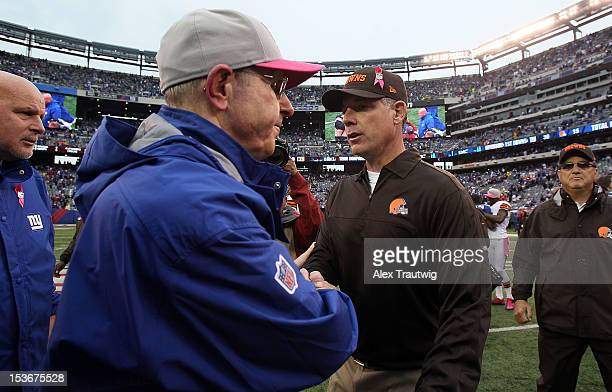 Cleveland Browns head coach Pat Shurmur meets with New York Giants head coach Tom Coughlin after their game at MetLife Stadium on October 7 2012 in...