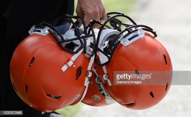 Cleveland Browns helmets are carried off the field prior to a preseason game against the New York Giants at MetLife Stadium in East Rutherford New...