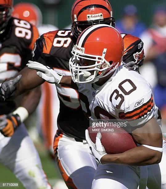 Cleveland Browns' Jamel White is pursued by Cincinnati Bengals' Brian Simmons 14 October 2001 at Paul Brown Stadium in Cincinnati OH Cincinnati...
