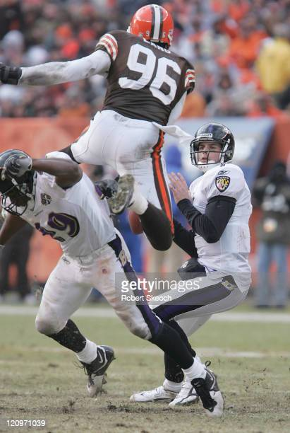 Cleveland Browns linebacker Kenard Lang leaps over a lineman to get at Baltimore Ravens quarterback Kyle Boller during the game at Cleveland Browns...
