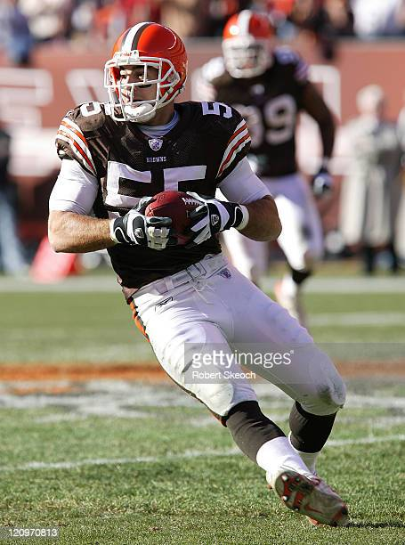 Cleveland Browns linebacker Matt Stewart runs for yards after an interception during the game against the Miami Dolphins at Cleveland Browns Stadium...