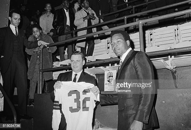 Cleveland Browns owner Art Modell is holding up number 32 jersey worn by Jim Brown which will be retired Jim Brown was honored 1/29 for his feats in...