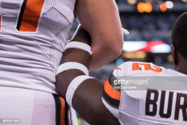 Cleveland Browns players kneel and lock arms during the national anthem before the NFL game between the Cleveland Browns and Indianapolis Colts on...