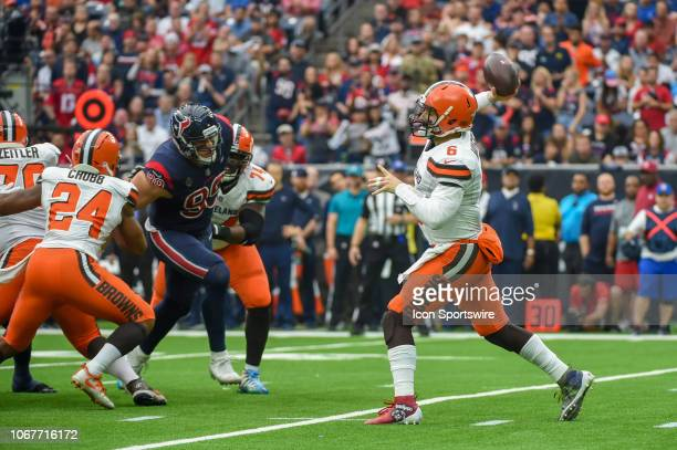 Cleveland Browns Quarterback Baker Mayfield gets his first half pass away as Houston Texans Defensive End JJ Watt breaks through the line to provide...