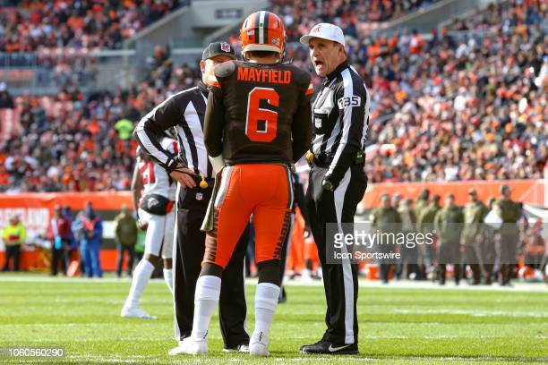 Cleveland Browns quarterback Baker Mayfield talks to referee Pete Morelli during the first quarter of the National Football League game between the...