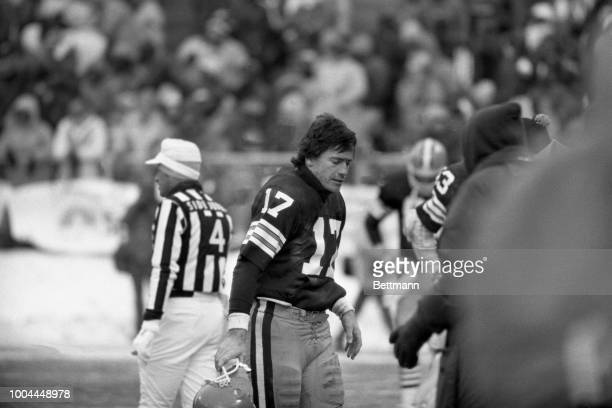 Cleveland Browns quarterback Brian Sipe walks off field following an interception of his pass in the final moments of game against Oakland Raiders...