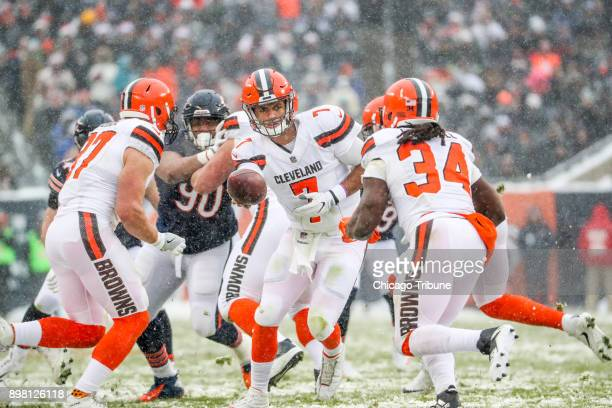Cleveland Browns quarterback DeShone Kizer hands the ball off to Cleveland Browns running back Isaiah Crowell during the first half at Soldier Field...