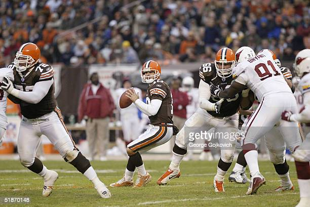 Cleveland Browns quarterback Kelly Holcomb sets to pass behind the blocking of offensive tackle Ryan Tucker and offensive guard Paul Zukauskas during...