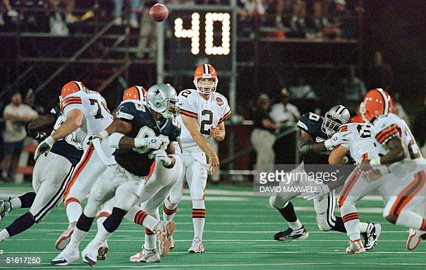 Cleveland Browns' quarterback Tim Couch delivers a pass in the second quarter of their AFCNFC Hall of Fame Game against the Dallas Cowboys 09 August...