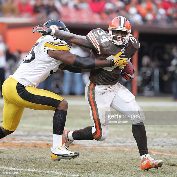 Cleveland Browns Reuben Droughns carries the ball while pushing off linebacker Joey Porter during the game against the Pittsburgh Steelers at...