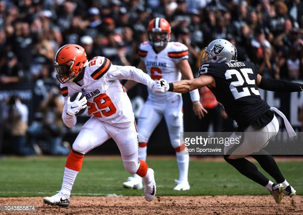 Cleveland Browns Running Back Duke Johnson evades the tackle of Oakland Raiders Safety Erik Harris during the NFL football game between the Cleveland...