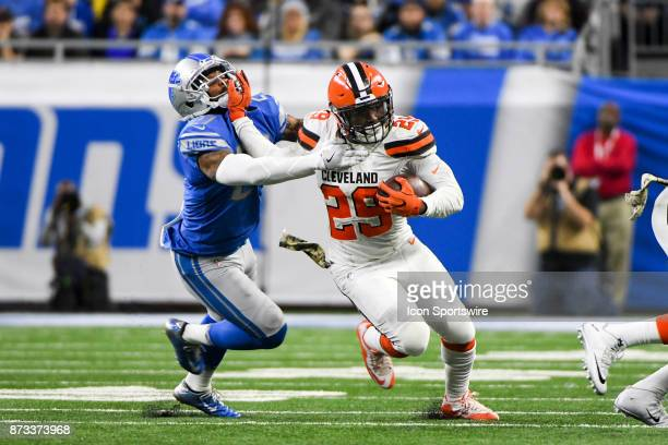 Cleveland Browns running back Duke Johnson stiff arms Detroit Lions free safety Glover Quin to run for a big gain during the Detroit Lions game...