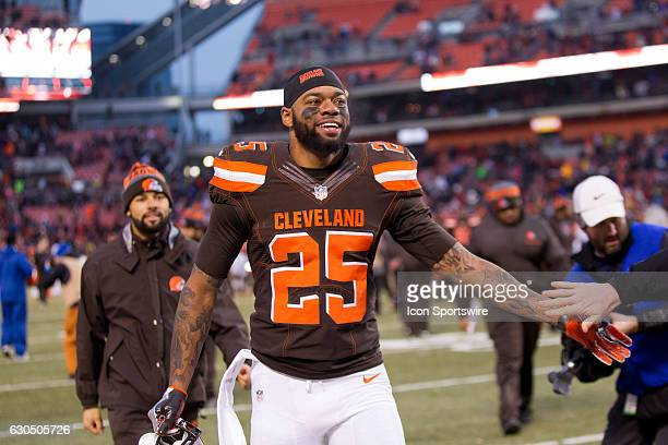Cleveland Browns Running Back George Atkinson III celebrates as he leaves the field following the National Football League game between the San Diego...