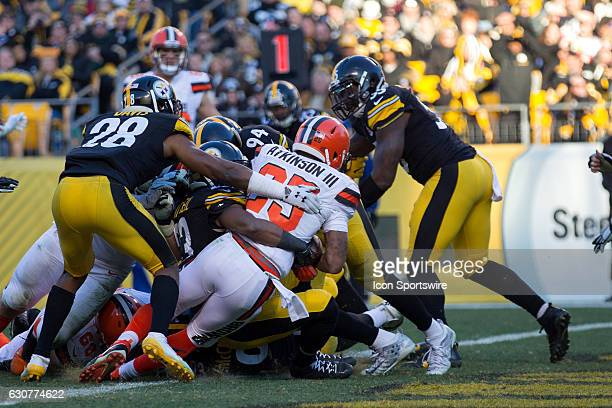 Cleveland Browns Running Back George Atkinson III leans over the goal line as he scores on a 5yard run during the fourth quarter of the National...