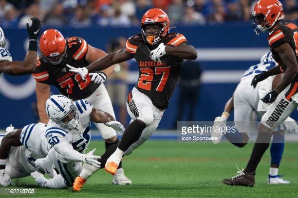 Cleveland Browns running back Kareem Hunt gets past a diving Indianapolis Colts linebacker Anthony Walker in game action during the week 2 NFL...
