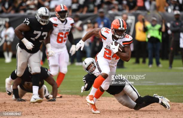 Cleveland Browns Running Back Nick Chubb after eluding the tackle of Oakland Raiders Safety Erik Harris on his way to scoring a touchdown run during...