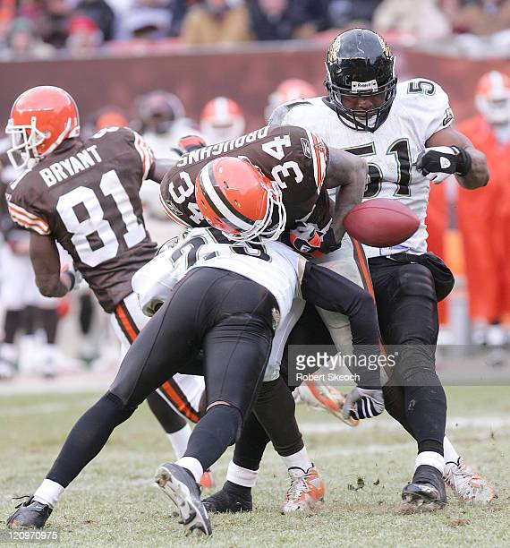 Cleveland Browns running back Reuben Droughns fumbles the ball versus Jacksonville at Cleveland Browns Stadium in Cleveland Ohio, Dec. 4, 2005. The...