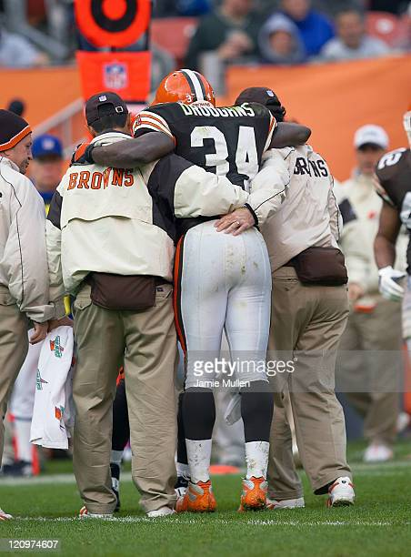 Cleveland Browns Running Back Reuben Droughns is helped off the field after struggling with cramps during the game against the Tennessee Titans...