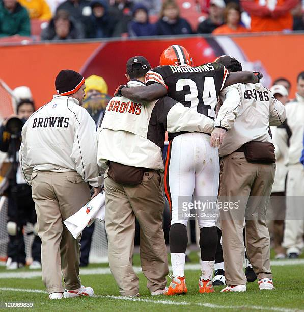 Cleveland Browns runningback Reuben Droughns leaves the field with a leg injury during the game against the Tennessee Titans at Cleveland Browns...