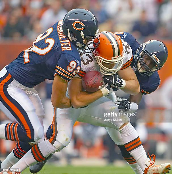 Cleveland Browns Tight End Aaron Shea is tackled by Chicago's Hunter Hillenmeyer during their game on Sunday October 9 2005 at Cleveland Browns...
