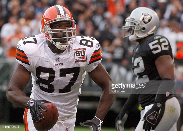 Cleveland Browns tight end Darnell Dinkins celebrates after scoring on a 3yard touchdown pass as Kirk Morrison of the Oakland Raiders walks off the...