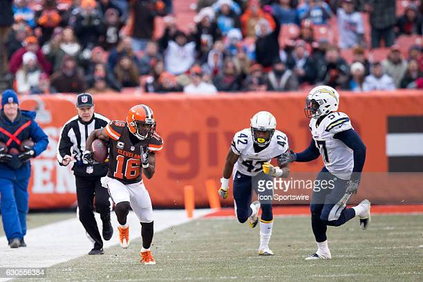 Cleveland Browns Wide Receiver Andrew Hawkins runs after making a catch as San Diego Chargers Cornerback Trevor Williams and San Diego Chargers...