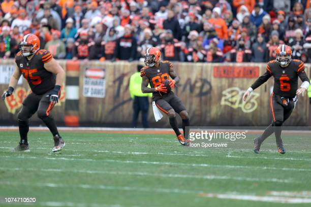 Cleveland Browns wide receiver Jarvis Landry looks to throw a pass as Cleveland Browns offensive guard Joel Bitonio and Cleveland Browns quarterback...