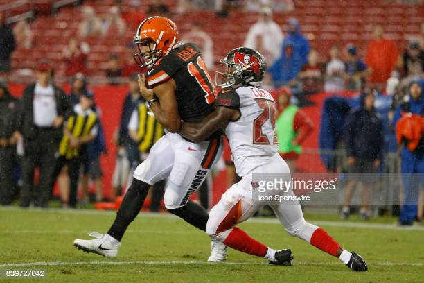 Cleveland Browns wide receiver Jordan Leslie catches a pass well being covered by Tampa Bay Buccaneers defensive back Matt Cooper for a touchdown in...