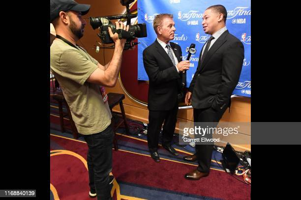 Cleveland Cavaliers broadcaster Fred McLeod interviews Tyronn Lue in Game Four of the 2017 NBA Finals on June 9 2017 at Quicken Loans Arena in...
