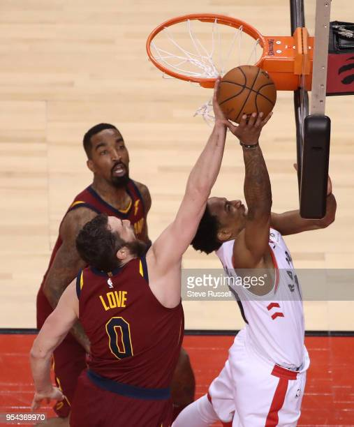TORONTO ON MAY 3 Cleveland Cavaliers center Kevin Love denies Toronto Raptors guard DeMar DeRozan under the basket as the Toronto Raptors play the...