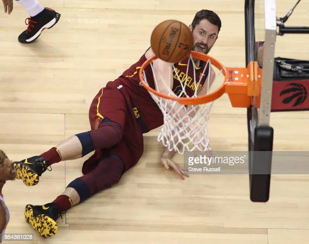 TORONTO ON MAY 3 Cleveland Cavaliers center Kevin Love falls to the floor after making an off balance throw as the Toronto Raptors play the Cleveland...